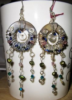 Donut wrap earrings with triple dangles featuring freshwater pearls and swarovski crystal bicones.  More details at whisperedreamsjewellery.blogspot.ca