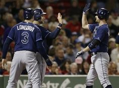 Jeff Keppinger celebrates a 3 run homer with Longoria and Scott