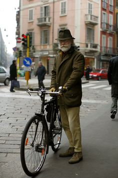 vintage bike, matching hat and coat, fitted pants, great white beard.