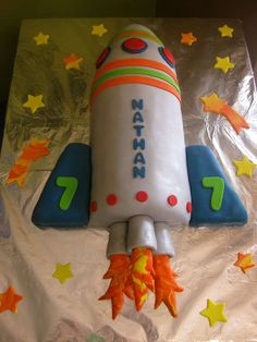 "This rocket birthday cake idea is perfect for a ""blast off"" outer space boy's birthday party!"
