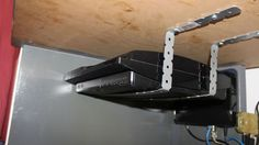 If you don't have space on top of your desk for all your hardware, like routers, DACs, or video game consoles, you can mount them to the bottom of your desk with a couple of cheap brackets.