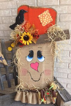 Covered in burlap, a wood pallet is the perfect base for this DIY Wood Pallet Scarecrow. Lean it against your porch or make a smaller version to place atop the mantel. This screams adorable!