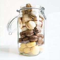 A big jar of 5 kinds of french macaroons: Chocolate, Coffee with Nutella, Coconut with White Chocolate and Raspberry, Lemon, and Vanilla!