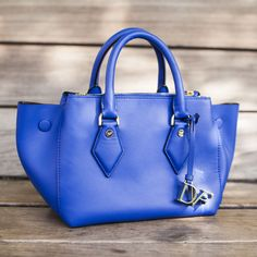 Chase away the blues with the DVF Voyage Double Zip Leather Satchel in lapis shock