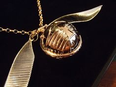 Asher Freeman Made A Golden Snitch Engagement Ring Box