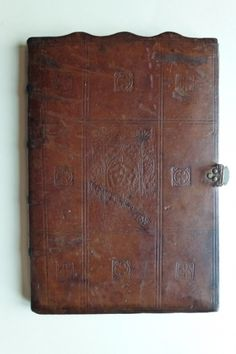 Richard Pynson was official printer to Henry VII and Henry VIII. It appears that he was also a bookbinder: the blind-stamped Tudor rose centre panel of this fine example of medieval English bookbinding, with alternating fleurs de lys and cinquefoils in the surrounding compartments, is said to be recognisably his. The binding covers an indenture made between Henry VII and Thomas Silkesteade, Prior of St Swithun in Winchester.