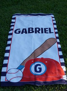 Custom printed beach towels make great anytime gifts. Know a baseball fanatic? This personalized towel contains graphics of a baseball, bat, and cap with the child's first name initial. Discover our exclusive collection.