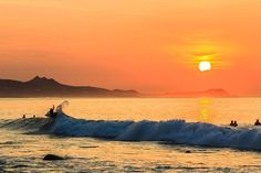 Top 10 things to do and enjoy around the Cabo. Surfing at Zippers near San Jose, Mexico.