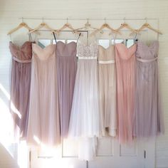 Annabelle Style from the Jenny Yoo collection (different colors than at BHLDN)... the one immediately to the right of the bride's and then the blush 2nd to the left of the bride's are the Cashmere and Cameo Pink colors. Note: none of the other purple colors