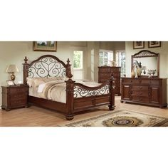 Sophisticated and grand in every way, this four piece bed set features a prominent and regal four poster bed with an expansive arching headboard that showcases an open floral design to match the metal curving footboard.