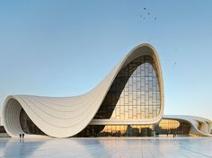 Azerbaijan's capital city, on the western coast of the Caspian Sea, is in the middle of rapid modernization, and Pritzker Prize–winning architect Zaha Hadid's building is an integral part of this process. Although dogged by delays (a fire broke out during construction) and controversies (Aliyev's government has been accused of limiting free speech, holding unfair elections, and corruption), it opened in early 2013 to an overwhelmingly warm reception.