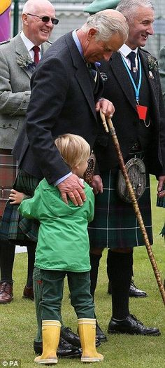 Touching: The Prince of Wales shares a hug with one of the Duchess of Cornwall's grandchildren: