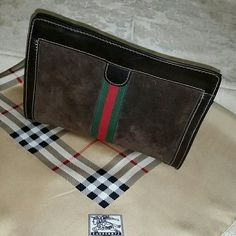 Authentic classic Gucci clutch/cosmetics case I purchased this beauty at the end of the seventies from a department store in So. California. Could have been Saks or Broadway or Bullocks. Only used a couple of times as an evening clutch. Excellent condition. Like new. Suede with polished matching leather trim. Waterproof interior. The Burberry scarf is also for sale in my closet. A vintage treasure. Gucci Bags Clutches & Wristlets