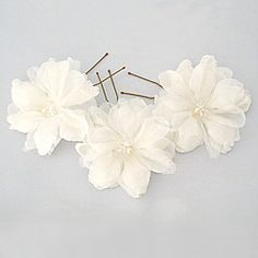 Laura Jayne bridal hair jewelry & flower hairpins at Perfect Details. Classic to avant garde hair flowers in a variety of sizes & unique details.