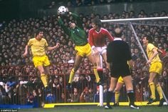 Zimbabwe's Bruce Grobbelaar claims the ball ahead of Manchester United's Gordon McQueen during a clash at Old Trafford in 1983