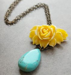 yellow rose and turquoise necklace. Reminds me of a Waylon Jennings song.