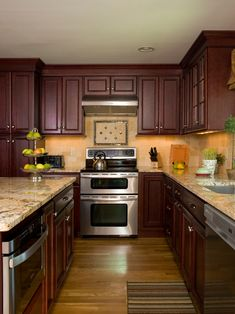 This kitchen features a centralized island supported by the Showplace Covington door style on cherry. This rich, traditional look is emphasized with bright hardwood flooring, countertop choice, and backsplash.  http://www.topnotchds.com