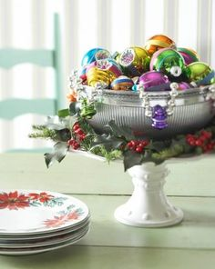 Create a colorful centerpiece by filling a silver bowl with an assortment of brightly colored ornaments. More Christmas centerpieces: http://www.midwestliving.com/homes/seasonal-decorating/easy-christmas-centerpiece-ideas/?page=2