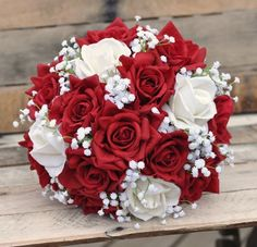 Classic wedding bouquet with red and ivory real touch roses…