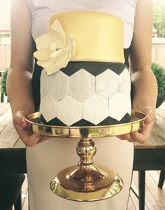Gold and black birthday cake with marbled hexagon detail