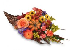 Order this Cornucopia Centerpiece w seasonal flowers & blooming w harvest accents! Perfect for your Thanksgiving table! #NashvilleFlorist