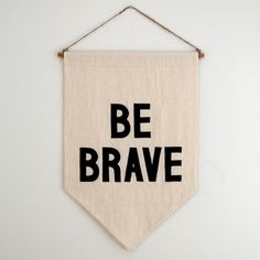 ----A simple reminder to have courage. Every day.----This banner is handcrafted from natural unbleached soft cotton flour sacks. The repurposed material varies slightly from piece to piece, assuring no two banners are exactly alike. The letters are hand cut from black wool felt and machine-stitched with black thread. The banner hangs from a hand-stained pine dowel, strung with twine. Each banner hangs about 22 inches long from a 16 inch wide dowel. ----$5 from ...