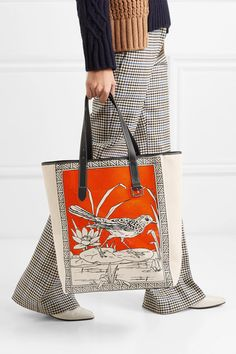 Ecru, orange and black canvas, black leather Open top Designer color: Tangerine Comes with dust bag Weighs approximately Made in Spain Leather Pouch, Leather Shoulder Bag, Orange Leather, Black Leather, Denim Cap, Cotton Tunics, Merino Wool Sweater, Leather Mini Skirts, Canvas Shoulder Bag