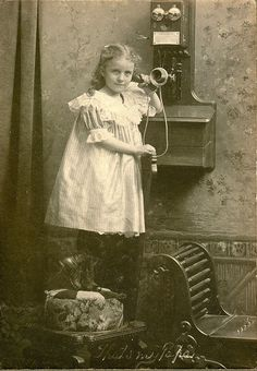 Girl on the telephone, circa 1900