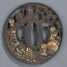 A Japanese iron maru gata tsuba with open work design of figures under a pine tree highlighted with gold, copper and saishoi. 18th/19th century. 7.2cm. 5.4mm thick.