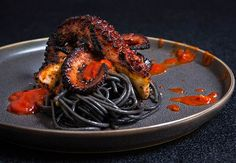 Grilled octopus over squid ink pasta and tomato garlic sauce - Viktoria's Table Seafood Recipes, Pasta Recipes, Cooking Recipes, Squid Ink Pasta, Squid Ink Spaghetti, Sicilian Recipes, Sicilian Food, Grilled Calamari, Octopus Recipes