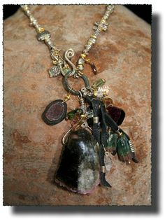 """Higher Forces"", There are things in this vast Universe we all inhabit, that escape our understanding and I wanted to evoke that thought. Parallel universes, unknown planets, and hidden powers were on my mind when I created this heart felt work. Sterling Silver, Watermelon Tourmaline, Peridot, Herkimer Diamond, Geode, Quartz Crystal, 24K Gold Vermeil, Ancient Celtic Money Ring by Allison Bellows"