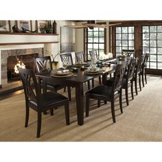 This table seats 10... http://www.hayneedle.com/product/a-america-montreal-rectangular-extension-dining-table-espresso.cfm
