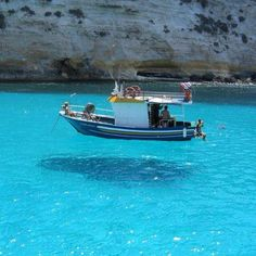 VISIT GREECE| Another stunning shot of boats seemingly suspended in aquamarine  jelly. The waters of the Greek Islands are crystal clear!