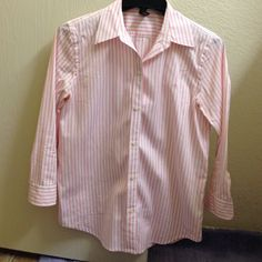 Ralph Lauren Shirt 100% cotton shirt, white with pink stripes. The label says size XS but fits a true S. Worn couple of times and dry cleaned. Ralph Lauren Tops