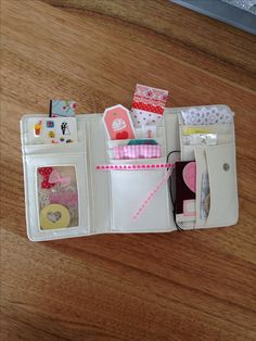 Sensory wallet for traveling on a plane with a baby ( 11 months) . Different textures, papers, foil, stickers, labels, ribbons l, Velcro. Hope it works!!