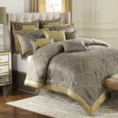 "Subtle shimmers of pewter and gold add to the luxurious look of the Garrison California king comforter set. The plush California king comforter and pillow cases are stitched into a windowpane quilted pattern, and edged with a wide matching gold border. Constructed of faux charmeuse, the Garrison California king comforter set has a silky finish that is soft to the touch. Set includes comforter, 16"" drop bed skirt, and two king size shams."