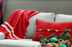 Love this combination of knitted throw and pillow