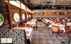 I have never seen a restaurant that looks like the inside of a ship before. This would really help to create a nice sea fairing ambiance. Just looking at this place makes me crave seafood.
