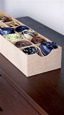 Use sock organizers for ties and belts                                              Sure, sock organizers are useful for keeping your drawers in tip-top shape -- But they also work just as well for ties and belts too.How to do it: -Purchase an inexpensive organizers (like this one from The Container Store) and fill with belts, ties and any other accessories without a proper home.Expert tip: Since these organizers are so slim, they slide well under beds and fit perfectly into drawers.