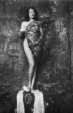 Ziegfeld Girl poses with a fan