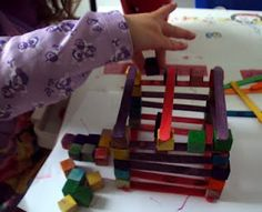 Blogger used this activity as a craft but that would be too expensive in a classroom, so I'd do this in the construction center or fine motor center: provide small cubes and popsicle sticks for building