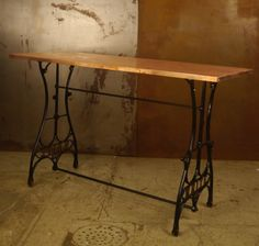 "Vintage cast iron sewing machine stand circa 1910 repurposed into a buffet table Product #: 900-950-0090 Size: 4' L x 18"" W x 29 1/4"" H Materials: Cast iro"