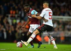 West Ham United's English midfielder Michail Antonio (L) vies with Manchester United's Argentinian defender Marcos Rojo during the FA cup quarter final replay football match between West Ham United and Manchester United at the Boleyn ground in London on April 13, 2016. / AFP / GLYN