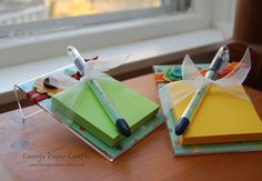 Post-It Note Stands using inexpensive, 4x6 acrylic picture frames, cute paper and a glue gun!