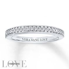 From the Vera Wang LOVE Collection, this captivating 14K white gold wedding band features 1/5 carat total weight of shimmering round diamonds. Intricate milgrain detailing completes this exquisite design. Lovely alone, this band was designed to complement most Vera Wang engagement rings. Buffed to a brilliant shine, this timeless design is a dazzling symbol of your love and commitment. Available online while supplies last. Diamond Total Carat Weight may range from .18 - .22 carats.