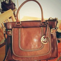 Love everything about this BAG...the color...the size...the style...the straps...