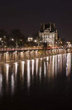 Quai à l'aile du Louvre, Paris...cruising down the River Seine on a warm spring night after having a romantic dinner at Tour Eiffel...
