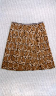 Peace Skirt. Alabama Studio Sewing + Design. Worked in backstitched reverse appliqué with camel-on-camel fabric and Tea embroidery floss.