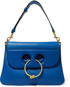 J.W.Anderson - Pierce Medium Leather Shoulder Bag - Cobalt blue  Available Colors: cobalt blue Available Sizes: one size Details  One of this season's hottest bags, J.W.Anderson's 'Pierce' is defined by its cutout front and chic gold circular barbell. This cobalt version is medium in size and has a detachable shoulder strap, so you can carry it as a clutch. We love the accordion structure that can be expanded or stay slim in profile depending on the desired look.