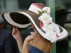 A spectator shows off her Derby hat before the 137th Kentucky Derby horse race at Churchill Downs in Louisville, Kentucky. Photo by © Ed Reinke/AP via ocregister.com
